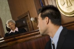 Judge looks at witness in court