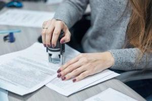 Woman stamps document from small claims court