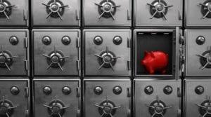Red piggy bank inside a small vault