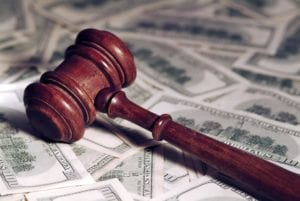 Gavel resting atop pile of money