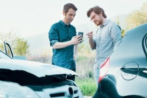 Two men making an agreement after a car accident