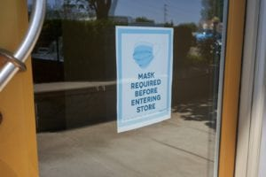 """Sign that says """"mask required before entering store"""""""