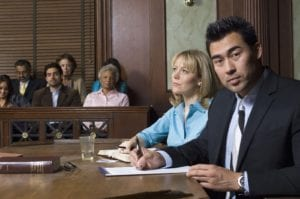 A lawyer sitting with a client in the courtroom