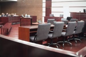 Courtroom with empty chairs before trial begins