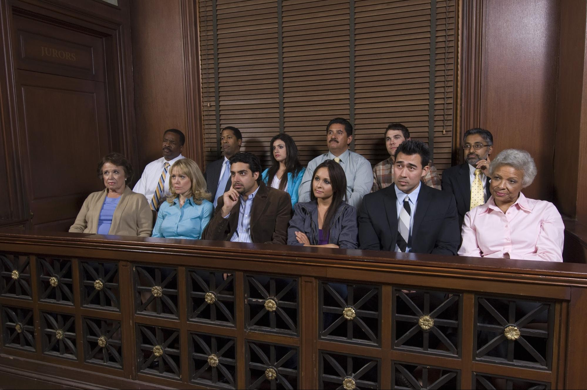 A panel of jurors inside a courtroom