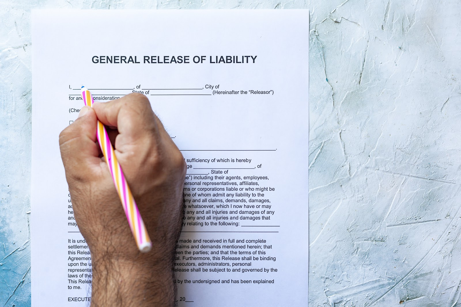 Man signing a General Release of Liability form