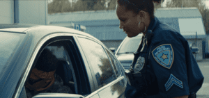 A female police officer talking to a car driver