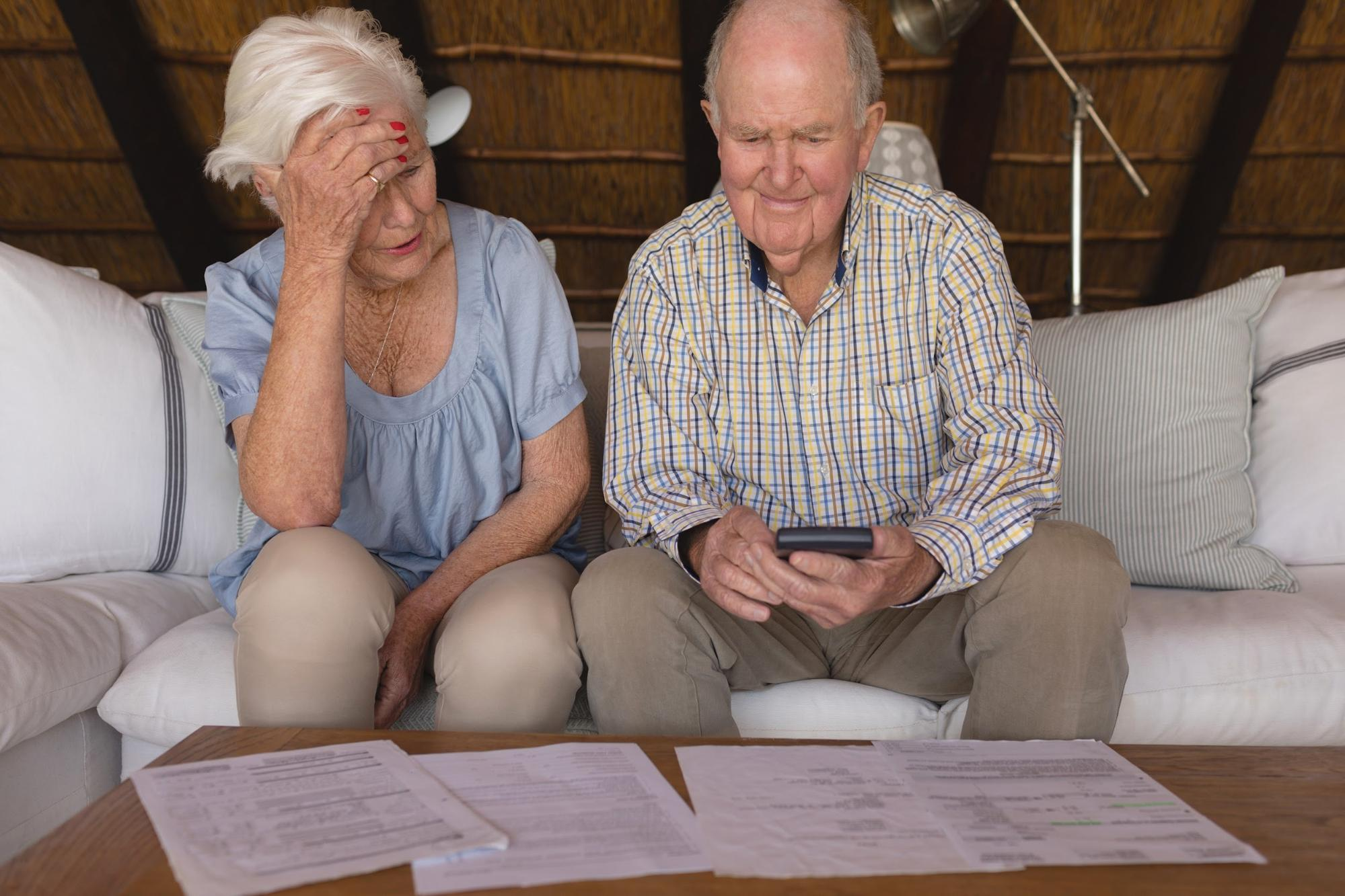 Elderly couple discussing and computing their hospital bills