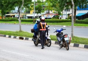 Traffic policeman talking to a motorcycle rider
