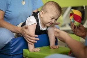 Baby undergoing physiotherapy
