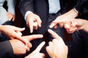 Group of people pointing fingers at each other