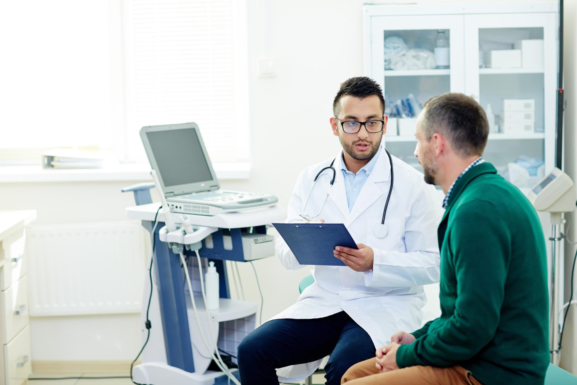 Male patient consulting with his doctor