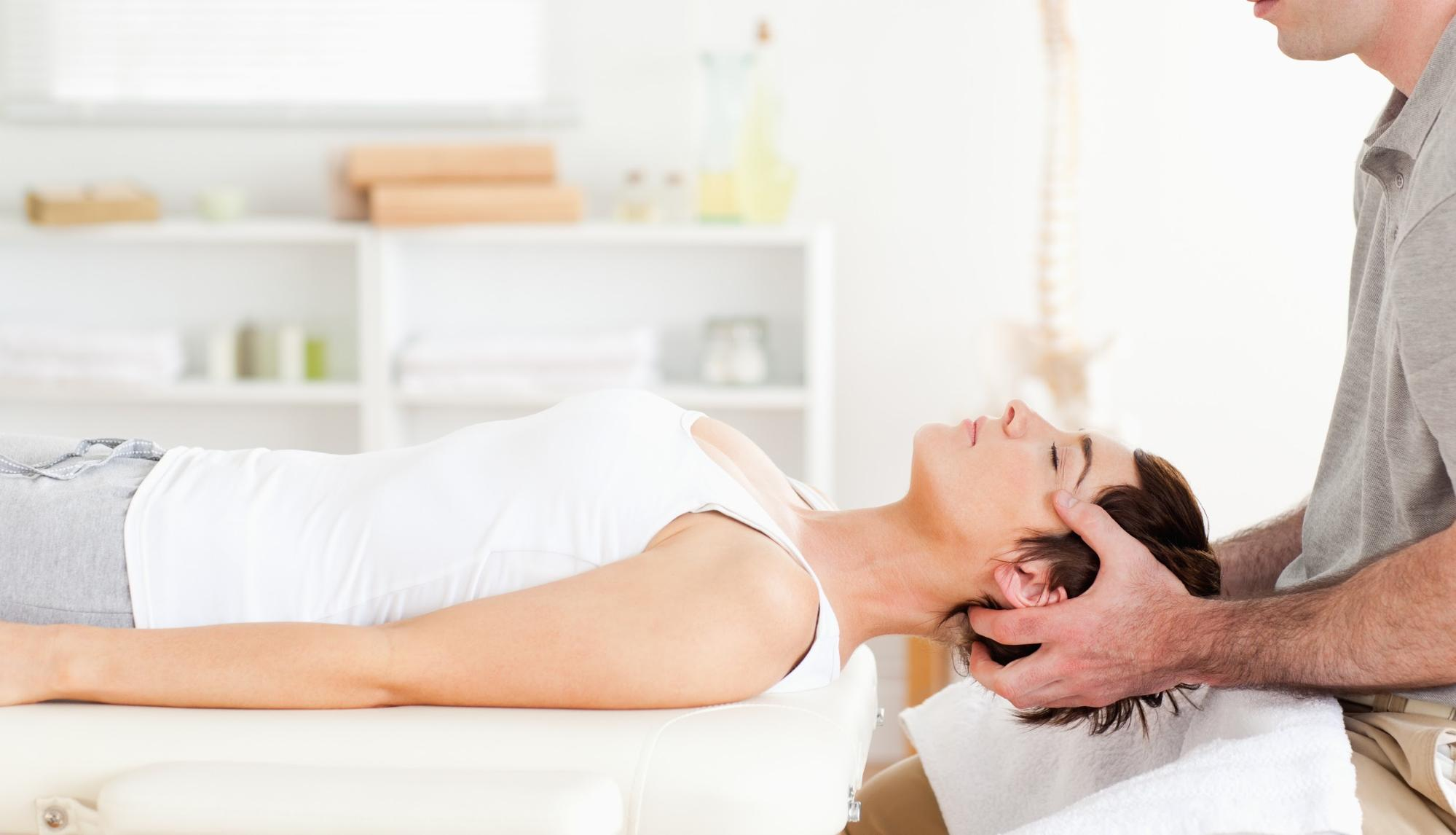 Chiropractor stretching a woman's neck