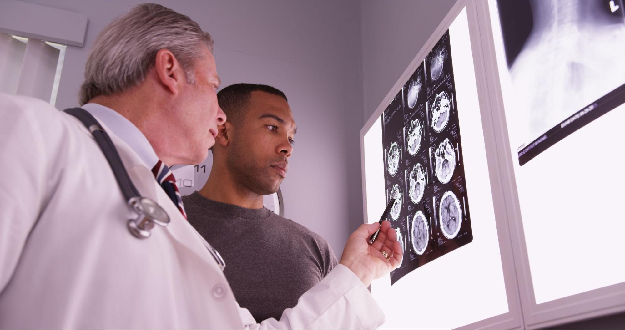 Doctor discussing X-ray results with a patient