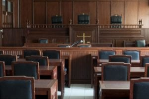 Empty courtroom with tables and chairs