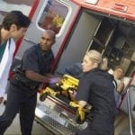 paramedics unloading a patient from the ambulance