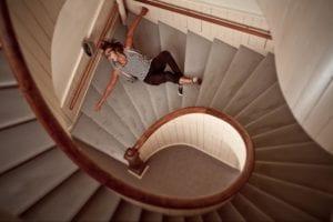 Man falling down a spiral staircase