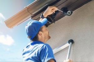 Man installing an outdoor security camera