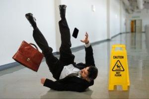 Man slipping on wet floor