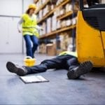 injured worker laying down on the floor