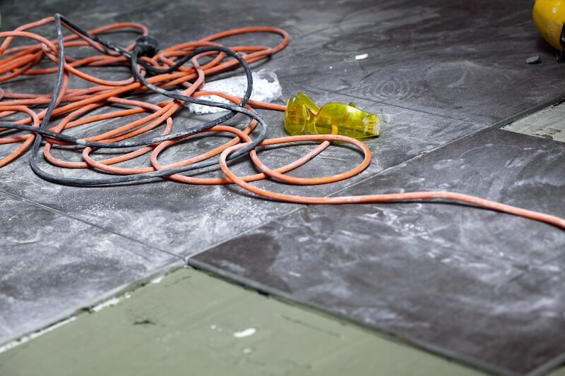 Coils of electrical cable on a dirty floor