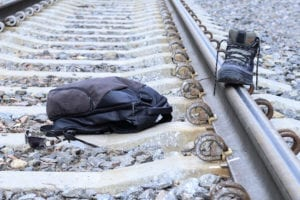 backpack and a shoe in a railroad